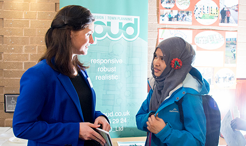 Recruiter talking to student at careers fair