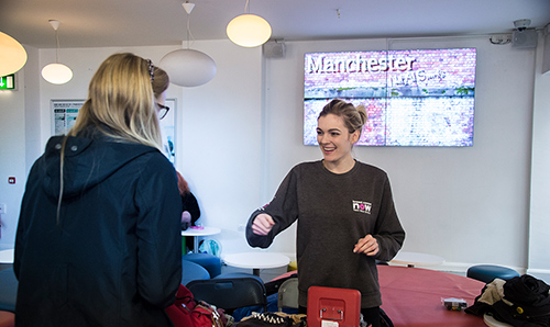 Female student smiling at RAG week event