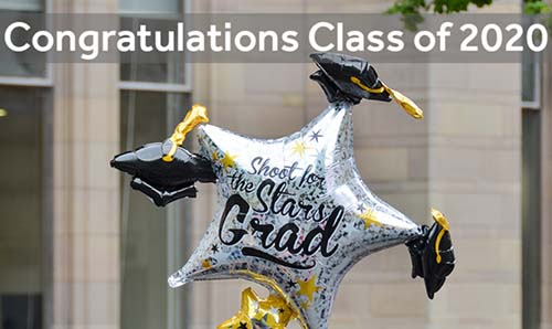 A congratulatory graduation balloon with text overlaid that says