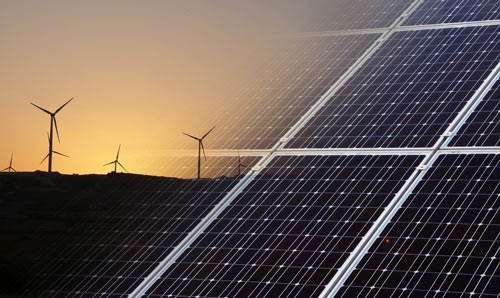 Stock image of wind farm and solar panels