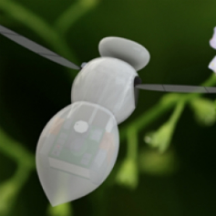 Close up of a tiny white robot in the shape of a bee