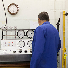 A researcher in the Geotechnics laboratory