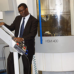 A researcher operating the Mikron HSM 400
