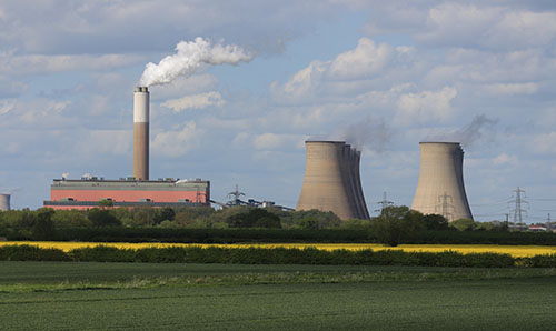 A power plant chimney emits steam