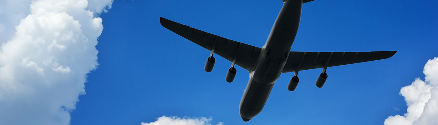 Airplane silhouette in deep blue sky