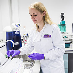 Female researcher working in medical lab