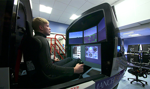 Undergraduate using flight simulator